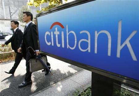 Men walk past a Citibank branch